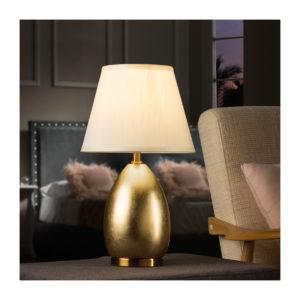 Lámpara de noche dorada con pantalla clara