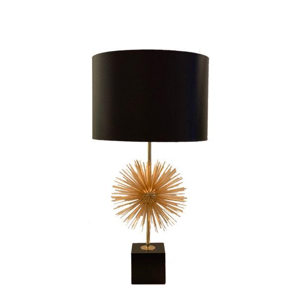 Lámpara de sobremesa dorada con forma de estrella