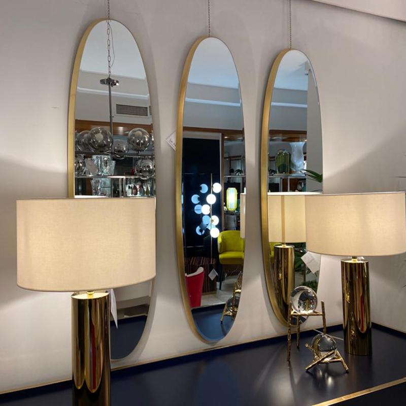 Espejo dorado alargado